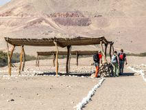 Chauchilla cemetery - prehispanic archeological site with protecting roofs in Nazca, Peru, South America.  stock photography