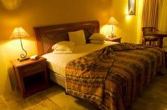 Chaudement chambre à coucher de Lit Photos libres de droits