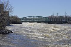 Wider angle view of the Chaudiere Bridge. Chaudiere Bridge with fast flowing water in the Spring, early summer Royalty Free Stock Images