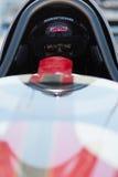 Chaufför i hans stång som är varm under världen av hastighet 2012. Arkivfoton