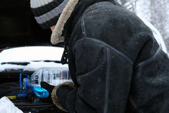 Chaufför With Windscreen Washer Royaltyfria Bilder