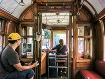 Chaufförtramcar i Porto, Portugal Fotografering för Bildbyråer