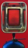 Chaufferette de gaz d'un rouge ardent images libres de droits