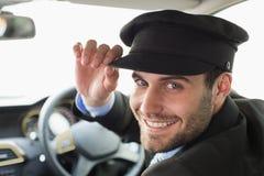 Chauffeur beau souriant à l'appareil-photo image libre de droits