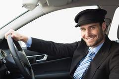 Chauffeur beau souriant à l'appareil-photo photos libres de droits