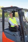 Chauffeur de camion de chariot élévateur Photos libres de droits