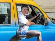 Chauffeur de taxi de Londres Image libre de droits
