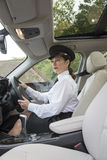 Chauffeur driving car Stock Images