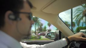 Chauffeur of elite taxi driving automobile in the city, responsible job, duties. Stock footage stock video footage