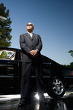 Chauffeur guarding car Royalty Free Stock Image
