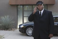 Chauffeur On Phone Call Stock Images