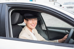 Chauffeur smiling at camera Stock Images