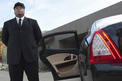 Chauffeur Waiting By Car Stock Photo