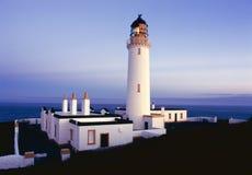 Chauffez du phare de Galloway au crépuscule, Ecosse Photos stock