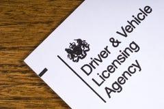 Chaufför och medel som licenserar byrån Fotografering för Bildbyråer