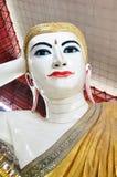 Chauk Htat Gyi Reclining Buddha Image at Kyauk Htat Gyi Pagoda in Yangon, Burma. Stock Photos