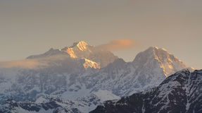 Chaukhamba peaks during sunrise from Deoria Tal lake Stock Images