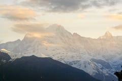 Chaukhamba peaks during sunrise from Deoria Tal lake Stock Image