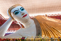 Chaukhtatgyi Paya, reclining Buddha in Yangon, Myanmar. Beautiful face of reclining Buddha in Yangon, Myanmar Stock Photo