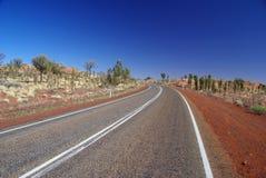Chaussée de stationnement d'Uluru - de Kata Tjuta Photos libres de droits