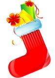 Chaussette rouge de Noël avec des cadeaux Photographie stock libre de droits