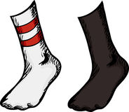 Chaussettes avec des pieds dans eux Photo libre de droits