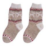 Chaussettes de laine d'enfants d'isolement sur le fond blanc Images stock