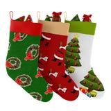 Chaussettes de Noël avec des cadeaux d'isolement Photo libre de droits