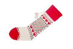 Chaussettes de Noël avec les points en forme de coeur à l'arrière-plan vert Images stock