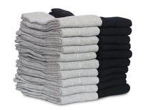 Chaussettes masculines d'une manière ordonnée pliées dans une pile Images stock
