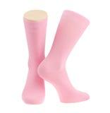 Chaussettes roses au-dessus de blanc Photos stock
