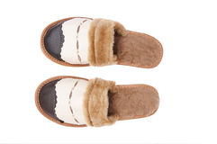 Chaussons soignés en cuir sur un blanc. Photo libre de droits