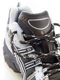 Chaussure de course rayée sur la première vue blanche Photo stock