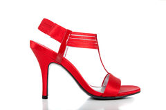 Chaussure de robe rouge de dames sur le blanc Photo stock