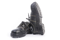 Chaussure de sécurité noire d'isolement Photographie stock