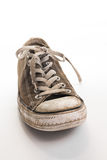 Chaussure de tennis sur le fond blanc Images libres de droits