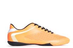 Chaussure orange de sport d'isolement sur le fond blanc closeup Photographie stock libre de droits