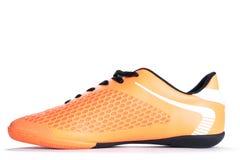 Chaussure orange de sport d'isolement sur le fond blanc closeup Images libres de droits