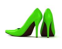 Chaussures à talons hauts à la mode vertes sur le fond blanc Image stock