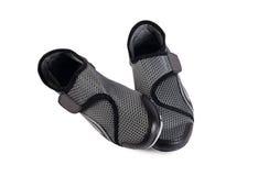 Chaussures élégantes noires de sport de femmes d'isolement Images stock