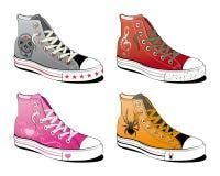 Chaussures avec le divers symbole Photographie stock libre de droits