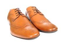 Chaussures bronzages au-dessus de blanc Photographie stock libre de droits