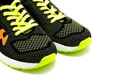 Chaussures courantes de sport d'isolement sur un blanc Image libre de droits