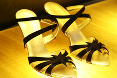 Chaussures d'or Photos stock