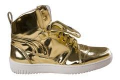 Chaussures d'or de sport d'isolement sur le blanc Photo libre de droits