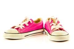 Chaussures d'enfants d'isolement sur le fond blanc accessoires de confort de style libre Image stock