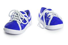 Chaussures d'enfants d'isolement sur le fond blanc confort de style libre coloré Photo libre de droits