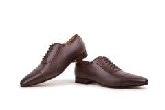 Chaussures d'homme d'isolement sur le fond blanc Image stock