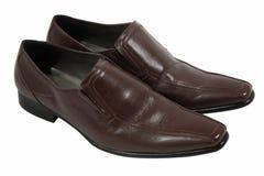 Chaussures d'homme de Brown d'isolement sur le blanc Photos stock