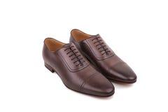 Chaussures d'homme sur le fond blanc Photo stock